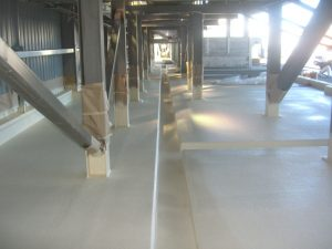 Concrete bund lined with RhinoChem 2170 chemical resistant polyurethane spray lining